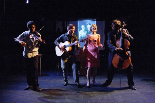 Josh Henderson as Ronnie on violin, Eric Richardson as Woody on guitar, Onalea Gilbertson as Shrike and Brian Sanders as Bill on Cello. Photo by C Stanley Photography