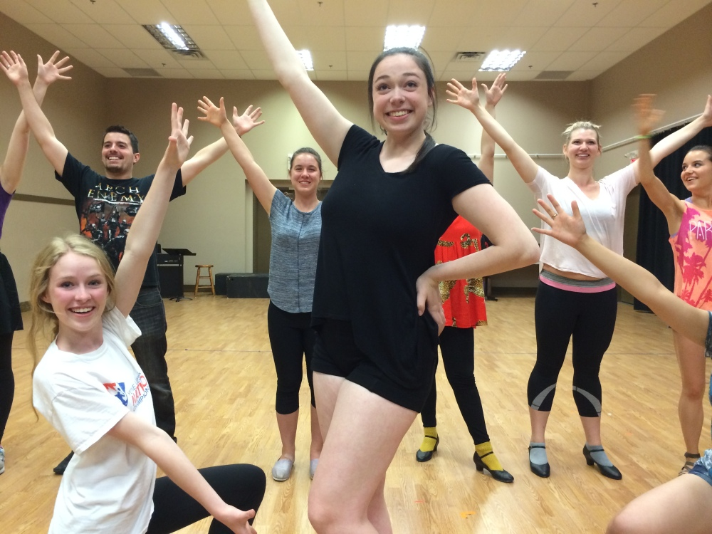 Liberty Laferriere (front) and the Cast of Thoroughly Modern Millie in rehearsal (photo courtesy of Youth Singers of Calgary)
